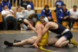 (DLM4397) -   Broomfield's Eric Mortensen , right, tries to wrap up Thompson Valley's Jason Horne...