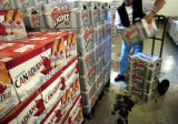 July 22, 2004. A Molson employee loads cases of Coor's Light onto a dolly at the brewers Toronto...