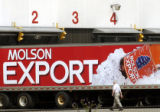 July 22, 2004. A Molson employee walks past an Export transport truck at the beermaker's flagship...