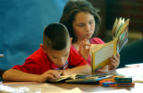 (Sheridan, Colo., July 7, 2004) Third grade students Matthew Rodriquez and Christine Christensen...