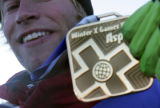 Andreas Wiig (cq) holds the gold asafter winning the  Men's Snowboard Best trick  finals at the...