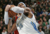 Denver Nuggets forward Carmelo Anthony is fouled hard in the fourth quarter of play  against the...