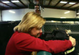 Camp Director Lisa Haight (cq) goes nose-to-nose with Daisy Smith while working at Camp Bow Wow in...