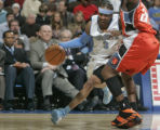 Denver Nuggets guard Allen Iverson drives on Charlotte Bobcats defender Raymond Felton, right, in...
