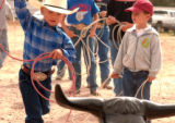 CHEYENNE, Wyoming, July 22,, 2004)Whit Kitchens,4, Mullin, Texas, was working his roping...