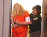 Shawna Nelson is led into court where she was charged with 1st degree murder in the death of...