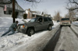 BG0226 James Frawley, CQ, an electrical contractor, helps his employer get his truck out of a...