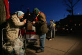 Marcia Friedman (cq), left, drops of her ballot to Gary Krogh (cq), right, at the curbside ballot...