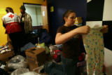 (DLM8228) -  Elyse Farrell, 17, right, sorts the clothes at the Springs of Life Church donated for...