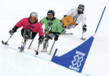 Mono skiers Tyler Walker, front, from Franconia, NH, Kevin Connolly, middle, from Bozeman, MT  and...