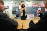 Teacher Susan Elliott (cq) teaches deaf students, Cameron Maki, 15, left, and Brett Koch, 16,...