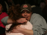 Tracy Meyer (cq), right, hugs fellow employee Florentina Marquez (cq)  Wednesday evening January...