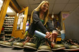 (DLM1855) -  Kim Collins, 20, puts away bowling shoes while working through work study at The...