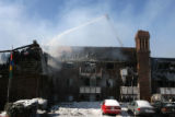 Fire continues to burn the Castle West Apartments Wednesday Jan. 17, 2007 in Colorado Springs,...