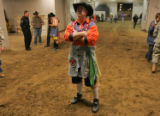 Professional bull fighter Lance Brittan of Windsor waits to enter the arena at the National...