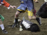 Professional bull fighter Lance Brittan, left, of Windsor, Colo., and fellow bull fighter Josh...