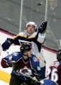 Predators # 11 David Legwand swats down a puck as he is defended against by Avs # 14 Ian...