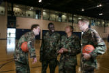 [JPM0073] Air Force Academy Falcons basketball players, from left Jacob Burtschi,  Dan...