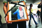 Cesar Gustavo Garcia Flores(cq) holds a picture of Luz Maria Franco Fierros in the atrium of the...