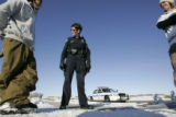 Snow boarders (L-R)  Jeff Cormack (cq) and Alex Cutler (cq) are approached  by Longmont officer...