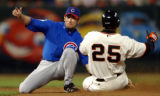 FXPB107 - San Francisco Giants' Barry Bonds, right, steals second base before the tag of Chicago...