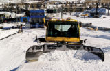 Zach Ornitz/Special to the Rocky Mountain News A snowcat crew shapes the superpipe at Buttermilk...