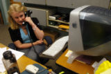 (DLM1824) -  Emilie Johnson, 21, talks on the phone behind the front desk of the School of...