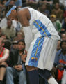 Denver Nuggets forward Carmelo Anthony holds his wrist after appearing to injure it it the fourth...