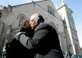The Bishop Acen Phillips is hugged by Dr. Claudette Sweet, a parishioner,  after worship at the...