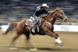 Brittany Pozzi-Pharr (cq), of Victoria TX rides a 15.37 during the final round of Barrel Racing to...