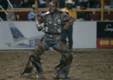 Justin Richards celebrates his 81 point ride with a touchdown dance in the middle of the arena,...
