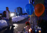 Antonio Alcon, 0f Denver, looks aat a memorial for Broncos player Darrent Williams at 11th and...