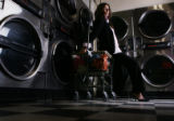 [JPM075]  Wash and wear clothes with Heather as Smiley's laundromat in central Denver. Machine...