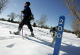 Cassy Knowles (cq) from Denver, snowshoes at the City Park Golf Course with her malamute, Mona,...