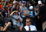 (CANTON, Ohio., SHOT 8/8/2004) John Elway makes his way past screaming Broncos' fans after a press...