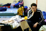 OKTUL105 - Jeremy Levie sits on a cot at the Red Cross Shelter setup at the Stipe Center, Tuesday,...