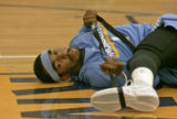 Newly acquired guard J.R. Smith stretches after attending his first practice as a Denver Nuggets...