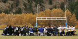 Players for Platte Canyon High School and Colorado Springs Christian School have a moment of...