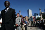 Augustino Majok, cq, left, from Sudan, waits to be sworn in as a United States Citizens in Civic...
