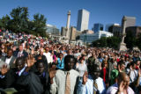 Close to 600 adults from over 80 countries raise their hands to be sworn in as United States...