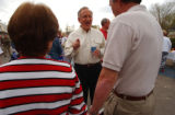 Charlevoix, MI, May 11, 2004--John Ramsey talks with supporters after he officially announced  his...