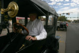Don Whissen, of Denver, drives a 1914 Touring Model T Ford, at a ground-breaking to seperate...