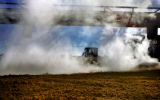 Steam rises from a pit of corn mash that is used as feed for cattle at  Sterling Ethanol LLC...
