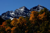 Afternoon light glows off aspen trees in front of the Maroon Bells  Tuesday evening September 19,...