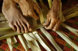 Kampong Leng,  Cambodia.  November 4, 2003.   Van Elle, 47, weaves a mat to sell in her home in...