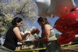 DLM01517   Shermey and Linda Cinco put down flowers and ballons in front of the house of...