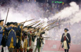 The New England Endzone Militia sequentially fires black powder muskets before the New England...
