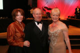 Nancy and Jeff Thompson, left, greet Sharon Magness Blake, one of the celebrity dancers for CNI's...