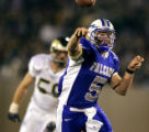 Air Force Falcons quarterback Shaun Carney (#5, QB) throws the ball downfield as the Colorado...