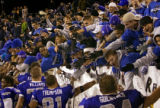 Air Force Falcons' fans celebrate with the team after a come from behind 24-21 win over the...